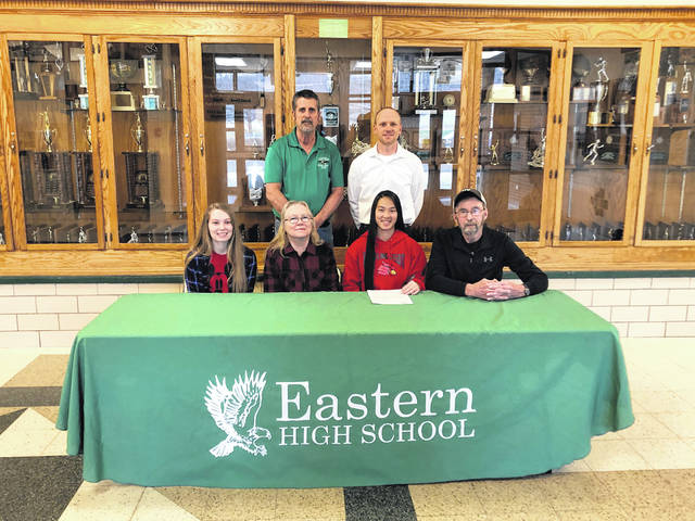 On March 29 at Eastern High School, Kylee Tolliver, seated second from right, signed her National Letter of Intent to join the Wheeling Jesuit women's golf team.
