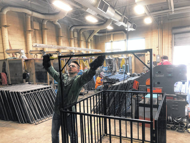 The drafting and welding students have been hard at work since January on their hog pen project. Pictured is a welding student working on portion of a hog pen.