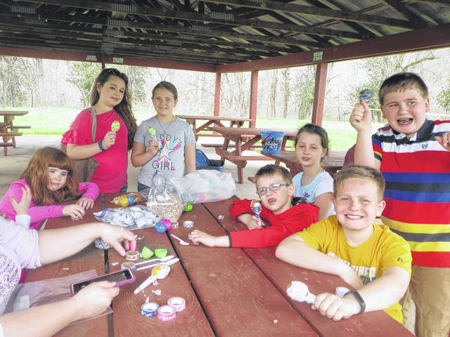 Pictured are Leon Luckies club members, from left, Marissa Thomas, Riley Springston, Brianna Miller, Makayla Hickman, William Hickman, Luke Thomas, and Wyatt Oldaker participating in the Easter egg recycling craft.