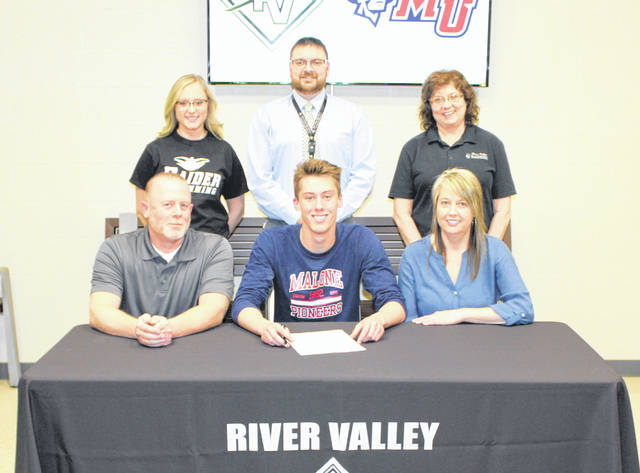 River Valley senior Cole Franklin, seated front and center, will be continuing his swimming career with Malone University after signing on Friday, April 5, at River Valley High School. Cole is joined by parents James and Carrie. Standing in back, from left, are RVHS swimming coach Robyn Schlater, RVHS Principal T.R. Edwards and assistant Regina Rhodes.