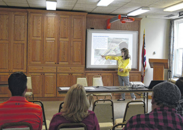 Beth Thornton, a lead engineer with Minnik and Smith Group, displays options to stakeholder for potential changes in the Ohio 7 and U.S. 35 interchange.
