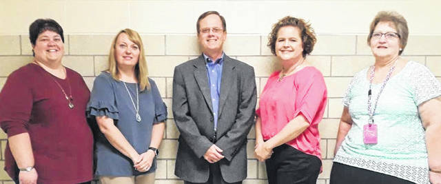 """John Hoback, center, a member of the Meigs County Community Fund advisory committee, recently presented awards and grants to four New Haven Elementary School teachers from a fund established by the late Dr. Harry Keig. Also pictured, from left, are Kira Northup and Jacque Richardson, recipients of the Excellence in Teaching Award, and Marla """"Dee"""" Ingels and Kathy Baker, recipients of classroom enrichment grants."""