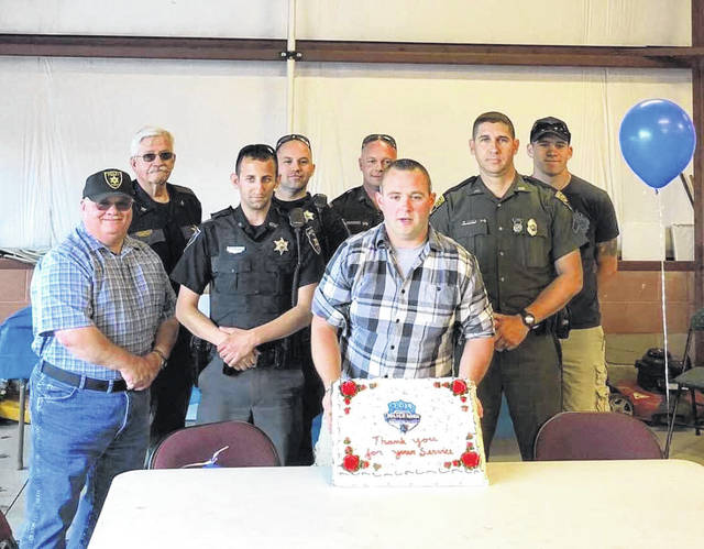Officers from municipalities, the sheriff's department, and state police came together Tuesday evening to attend a pig roast and cookout, hosted by the dispatchers from Mason County 911, as part of National Police Week, May 12-18.