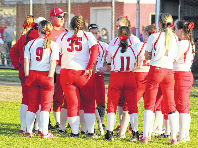 Wahama head softball coach Chris Noble, wearing cap, talks with his troops following a Game 1 loss to Sherman in the Class A Region IV tournament on May 14 in Hartford, W.Va.