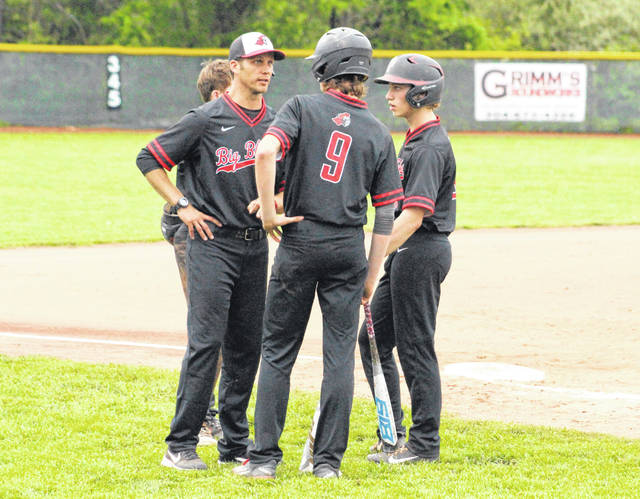 Point Pleasant baseball coach Andrew Blain talks with Kyelar Morrow (9) and others during a pitching change in an April 25 baseball contest against Chapmanville in Point Pleasant, W.Va.
