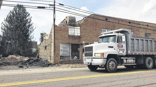 A commercial building in the downtown area of Mason was razed late Wednesday afternoon. Owners John and Alicia Jacobs said they plan to make the area into green space, and eventually have a mural painted on the adjoining building that they also own.