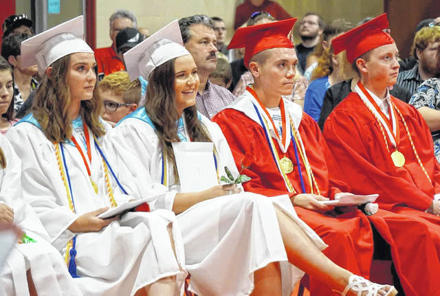 "Top students came down from the stage during commencement at Wahama Friday to watch their memories play on an overhead screen, while the class tribute, ""You're Gonna Miss This"" played. From left are Hannah Billups, third in the class; Alexa Layne, second; Jacob Lloyd, first; and Bryce Meadows, senior class president."