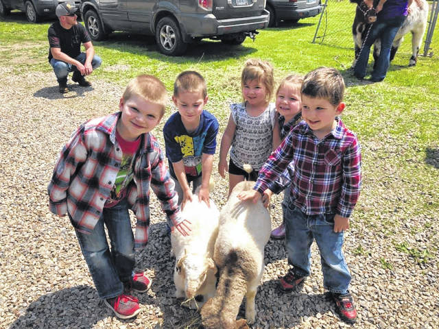 With the help of Fitch Family Farms in Long Bottom and Triple J Farm & Livestock Transport in Waterford, children an Munchkin City recently had a visit from several farm animals. The children had been celebrating Farm Week, learning about animals and doing other farm related activities, with the week capped off by a visit with goats, cows and other animals.