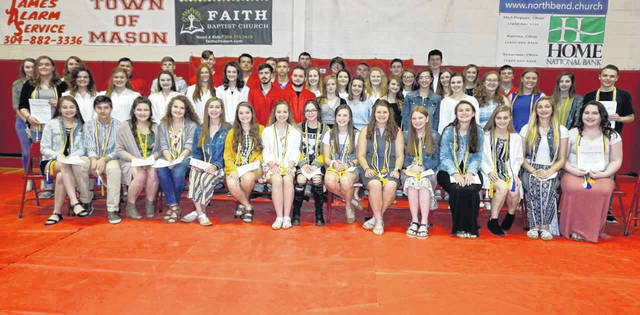 Members of the Wahama National Honor Society are pictured with fellow students who were newly selected for the organization. The new members were tapped into the society during a ceremony in front of their peers and family.