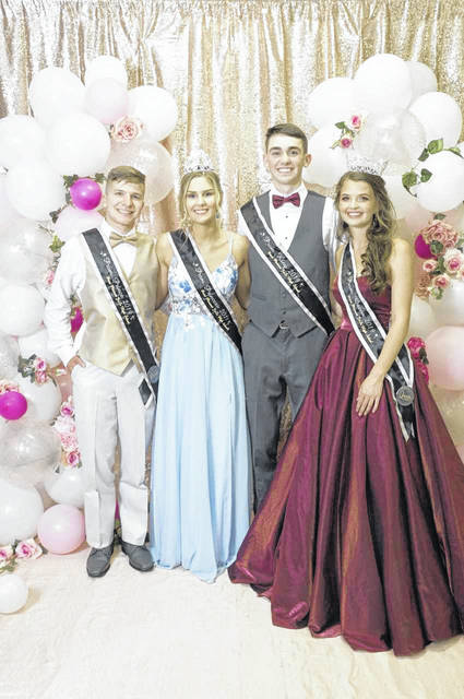 Saturday's rain didn't dampen the spirits of those attending the Point Pleasant High School Prom. Pictured are members of this year's prom court, from left, Junior Prince Isaac Daniels, Junior Princess Gavyn Buskirk, Senior Prom King Sam Pinkerton, Senior Prom Queen Caroline Foreman.