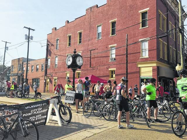Cyclists preparing for their ride at the inaugural Bikes and BBQ event.