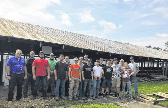 The welding students at MCCC have been working hard on the hog pen project at the Mason County Fairgrounds, pictured with the students are Stephen Littlepage, Brent Hereford, and Curtis McConihay.