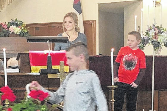 Youth of Middleport First Baptist Church presented flowers to the mothers after the Morning Worship Service on Mothers' Day. Pictured are Aubree Lyons, back left; Marc McCloud, back right; Bryce Zuspan, front.