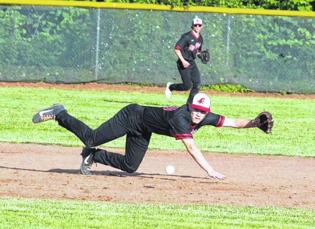 Point Pleasant junior Hunter Blain dives for a groundball at shortstop during the fourth inning of Game 2 in the Class AA Region IV Championships held Tuesday night against Scott in Point Pleasant, W.Va.