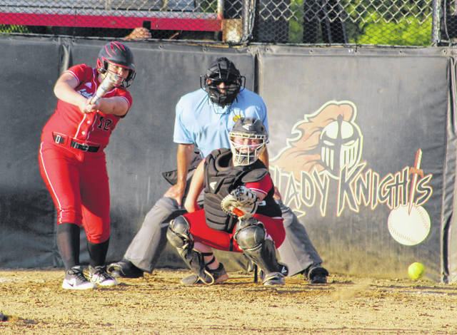 Point Pleasant freshman Annabelle Shrader (12) knocks out a single to left field during the sixth inning of Monday night's Class AA Region IV, Section 1 softball contest against Nitro in Point Pleasant, W.Va.