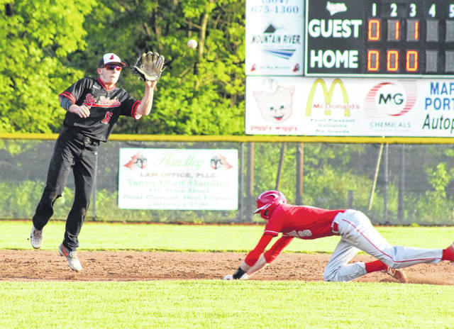 Point Pleasant senior Carter Smith, left, leaps for a throw on a stolen base attempt at second during the fourth inning of Tuesday night's Class AA Region IV, Section 1 winner's bracket semifinal baseball game against Poca in Point Pleasant, W.Va.