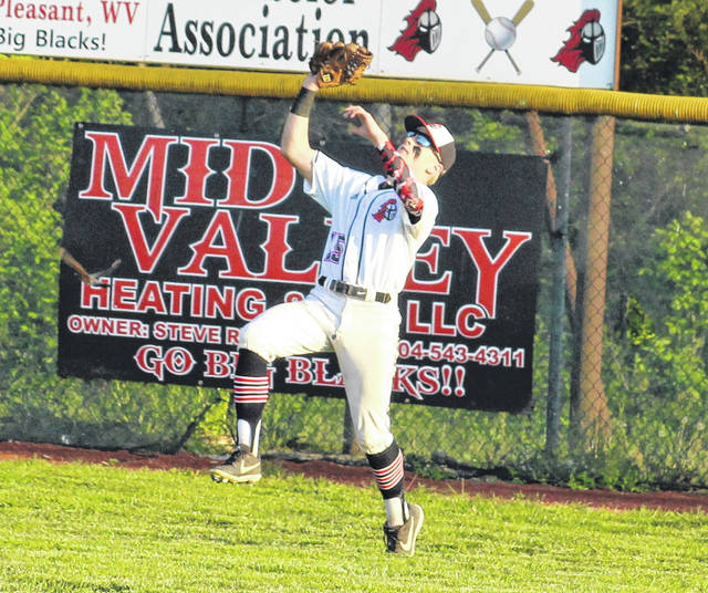 Point Pleasant sophomore Wyatt Wilson tracks down a fly ball in right field during the first inning of an April 30 baseball game against Ripley in Point Pleasant, W.Va.