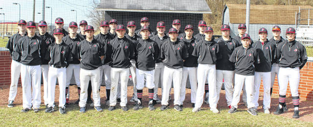 Members of the Point Pleasant baseball program pose for a picture in front of the backstop at the beginning of the 2019 spring sports season in Point Pleasant, W.Va.