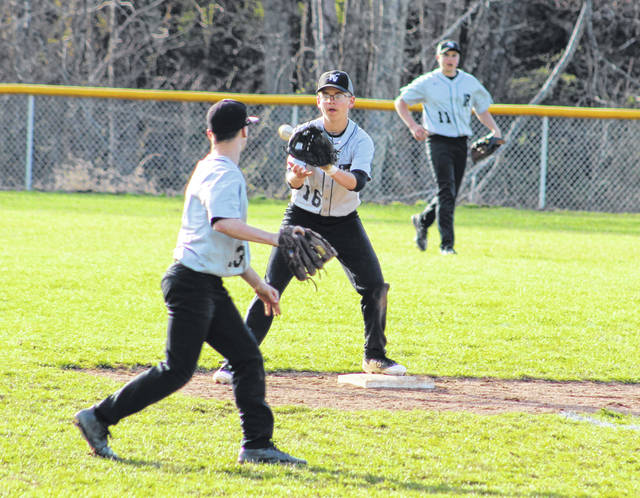River Valley sophomore Chase Barber (16) takes a throw at second base during an April 1 baseball game against Meigs in Bidwell, Ohio.