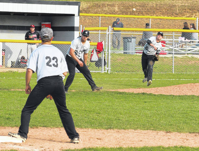 River Valley third baseman Joel Horner, right, relays a throw to first baseman Alex Euton (23) during an April 10 TVC Ohio baseball contest against Alexander in Bidwell, Ohio.