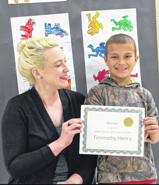 Timmothy Henry, third grade student at Beale Elementary School, pictured with his teacher Rachel Allinder, was recently awarded a $500 scholarship for his essay submission in the When I Grow Up Smart529 essay contest.