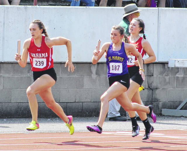 Wahama junior MacKenzie Barr (239) takes off down the home stretch after receiving a baton exchange from sophomore teammate Abbie Lieving during the Class A 4x100m relay finals held Saturday at Laidley Field in Charleston, W.Va.