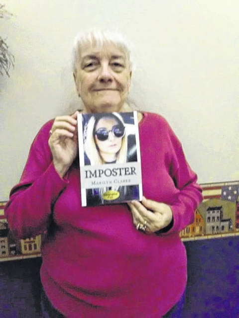 """Marilyn Clarke pictured with her book """"Imposter."""""""