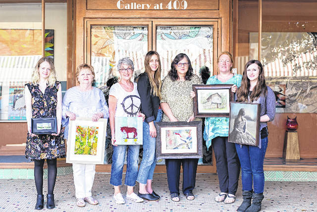"The artists for the ""Magnificent 7"" show pictured together, from left, Jessica Ashley, Janet Strohl, Cheryl Lund, Kelsi Boyd, Pam Conley, Courtney Lowery, Emalea Rupe."