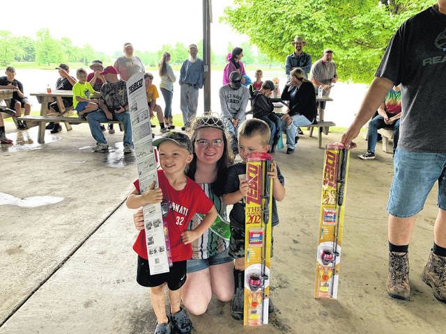 Pictured with Alasaundra Reed, Junior Miss 4-H, are the winners of the Fishing Rodeo in the zero-5 age division. The winner for catching most fish was Cale Jones; the winner for catching the largest fish was Grayson Adams; and the winner for catching the smallest fish was Abel Dennis.