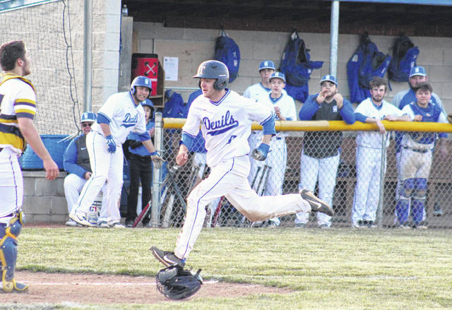 GAHS senior Wyatt Sipple scores the final run of the Blue Devils' 2-0 victory over South Point on April 3 in Centenary, Ohio.
