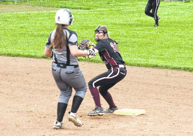 Meigs senior Ciera Older steps on second base for a force out and then throws to first, during the Lady Marauders' TVC Ohio bout against River Valley on April 17 in Rocksprings, Ohio.