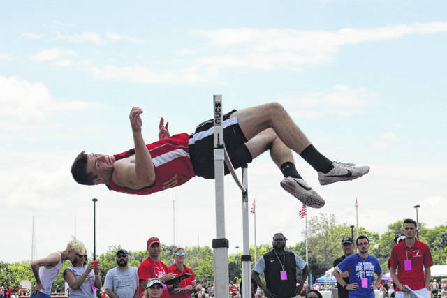 South Gallia junior Kyle Northup clears the bar at 6-0 in the high jump, during the opening day of the OHSAA state meet at Jesse Owens Memorial Stadium in Columbus, Ohio.