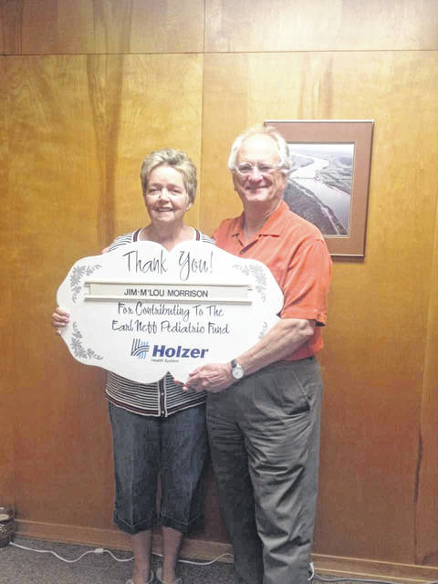 This month's sponsors are VFW Post #4464 represented by Jim and M'Lou Morrison, pictured.