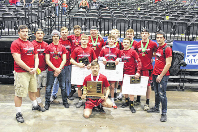 Pictured are all 14 qualifying members of the 2019 Point Pleasant wrestling team that captured the WVSSAC Class AA state championship at Big Sandy Superstore Arena on Saturday, Feb. 23, in Huntington, W.Va. The Big Blacks won the program's fourth state title since three-peating from 2010 through 2012.