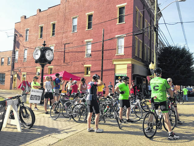 Cyclists arrive for registration at a previous Bikes&BBQ event. This year new features were added to the newly named Bikes, BBQ & Bluegrass, to expand offerings at the festival in downtown Point Pleasant.