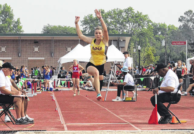 Meigs senior Kassidy Betzing leaps through the air in the Division II girls long jump, during the OHSAA state championships on Saturday in Columbus, Ohio.