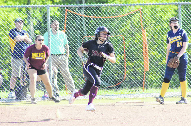 Meigs senior Taylor Swartz rounds first base on her way to a triple, during the Lady Marauders' win over South Point on May 7 in Rocksprings, Ohio.