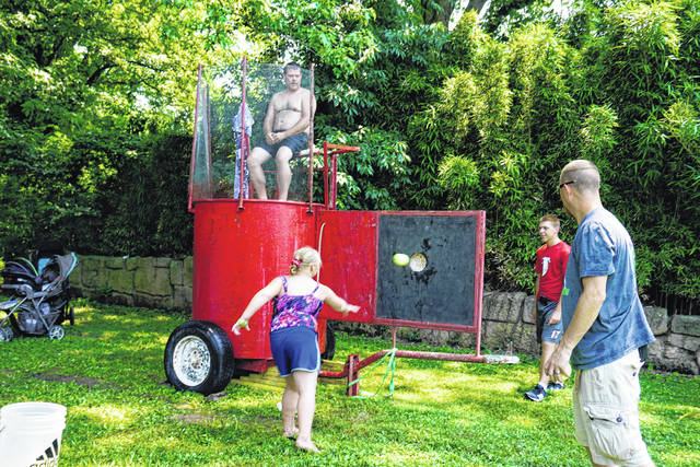 Mason Volunteer Fire Department members manned a dunk tank at the July 4 celebration. Firefighter Steven Darst, shown atop the tank, might have had the coolest job of the day.