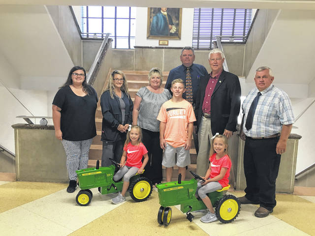 The Mason County Commission recently purchased two new pedal tractors for the Mason County Junior Fair Board members. Those pictured, from left, are Mariah Jones, Junior Fair Board Advisor Leticia Loomis, Commissioner Tracy Doolittle, Nathan Wood, County Administrator John Gerlach, President of Commission Rick Handley, Commissioner Sam Nibert, and Jaelyn and Kaelyn Wood in front.