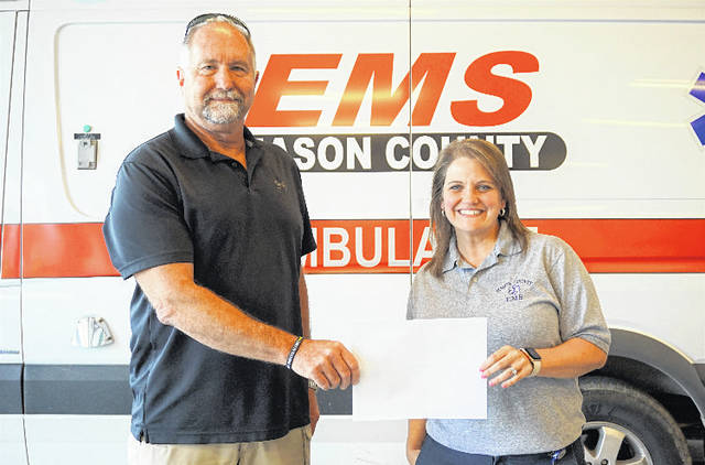 Elisabeth Lloyd, right, has been named the West Virginia Emergency Medical Technician of the Year. She is shown with Dennis Zimmerman, Mason County EMS director, who was one of two nominating Lloyd. Also nominating her was Andrea Darr, director of the West Virginia Center for Children's Justice.