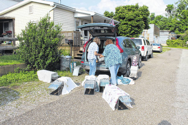 Cammy Simpkins, at left, and Renee Wickline, of the Mason County Kitty Korral, prepare humane traps for community cats. The Kitty Korral provides free spay and neuter services for those cats.