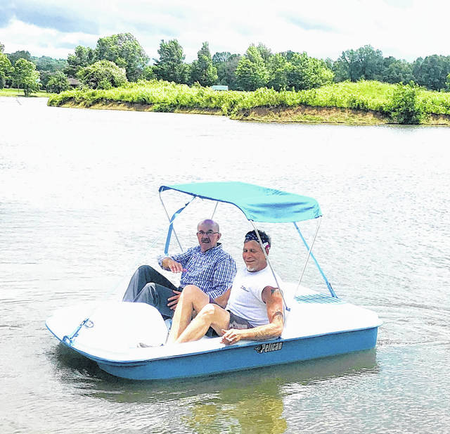 Mayor Brian Billings and Butch Bonecutter from the Street Department testing out the new pedal boat.