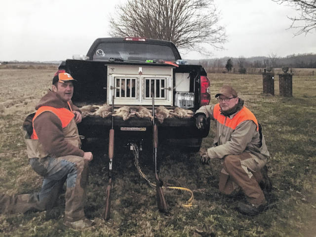 T.D. Dennis and Keith Pridemore pictured with their's and Greg Hartley's rabbits from a recent hunting trip.