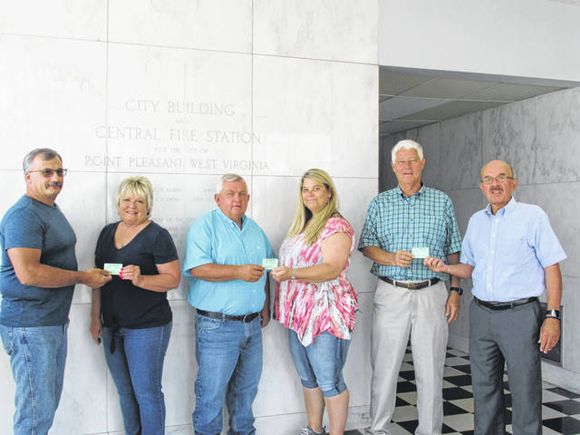 The 2019 Mason County Fair first tickets have been sold to the Mason County Commissioners Tracy Doolittle, Sam Nibert, and President Rick Handley. Those pictured, from left, are Mason County Fair President Shawn Paugh, Commissioner Tracy Doolittle, Commissioner Sam Nibert, Mason County Fair Treasurer Nicki Hunt, President of the Commissioner Rick Handley, and Mason County Fair Vice President Brian Billings.