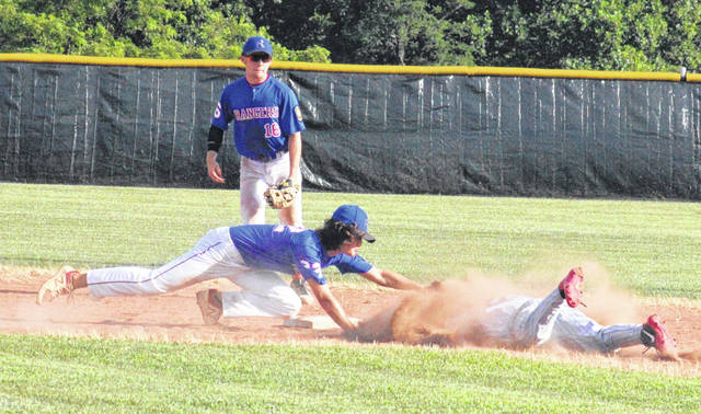 Post 39 second baseman Cole Arnott tags a Beverly Lowell runner out in front of Rangers' shortstop Carter Smith, during Tuesday's game at Meigs High School in Rocksprings, Ohio.