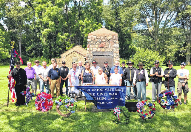Participants and organizers of the Battle of Buffington Island Memorial Service are pictured in front of the Battle of Buffington Island monument.