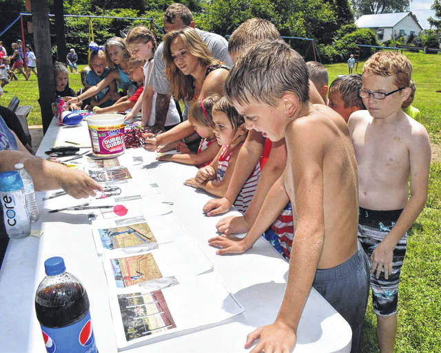 Children attending the Mason Fourth of July festival had the opportunity to choose which piece of playground equipment the town would purchase next for the park. The winner was a dome climber, which has already been ordered. Pictured are several of the children as they vote.