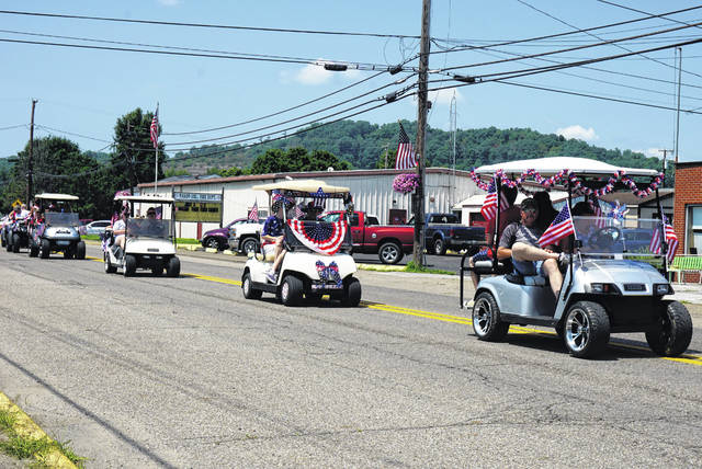 At last year's Mason Fourth of July parade there were several decorated golf carts, pictured is a section of the convoy. Point Pleasant will offer a contest for decorated golf carts in its Liberty Fest parade.