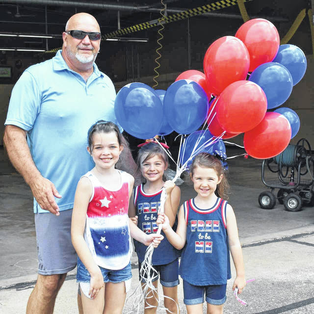 New Haven Mayor Greg Kaylor had a little help from granddaughters Britlyn, Emma and Ella, as he passed out balloons prior to the New Haven Fourth of July parade. The town also hosted free swimming at the municipal pool and a water slide to mark the holiday.