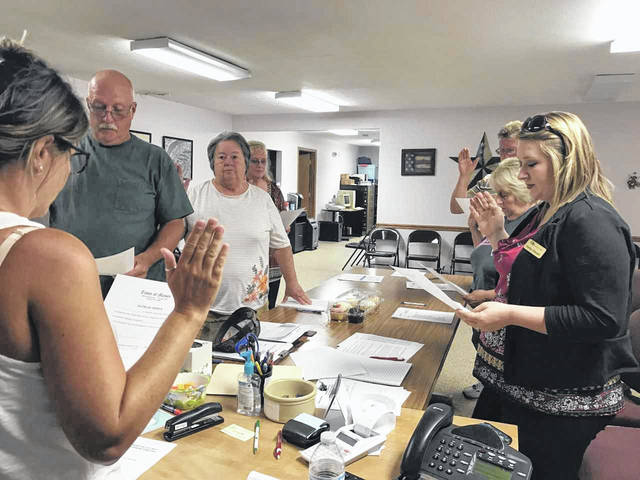 Mayor Donna Dennis is shown as she administers the oath of office to the new administration for the Town of Mason on July 1. Pictured, from left, are council members Marty Yeager, Sharon Kearns, Sarah Stover, Steve Ohlinger, Becky Pearson, and Recorder Harley Stewart.